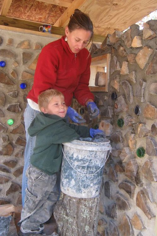 Karen and Everett dig into the mortar bucket to get the next handful of mud.  Playing in the mud is so much fun!