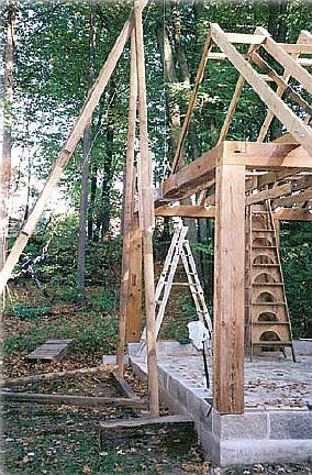 "Tom used what he terms a ""truss derrick"" to place his top plate and trusses on the framework."